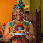 AFRO-CARIBBEAN WOMAN WITH CARIBBEAN FOOD